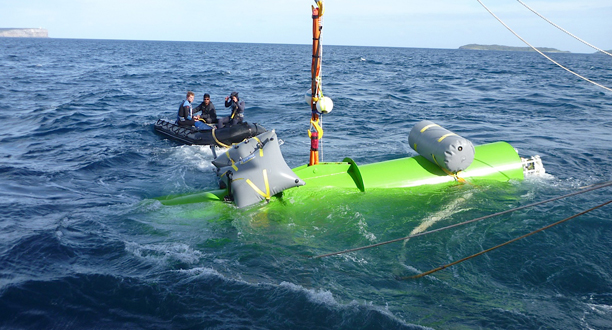 Photo: The dummy sub is lifted out of the water