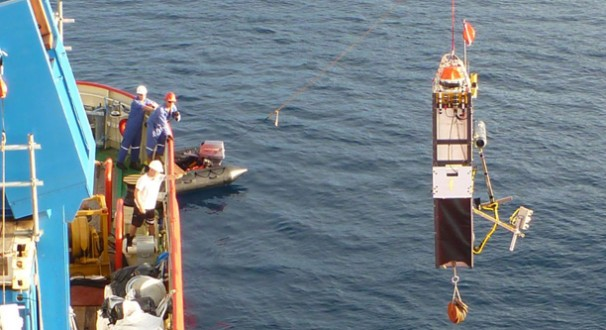 Photo: A lander is lowered into the ocean