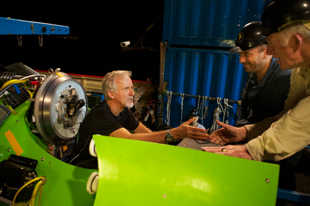 <em>Photograph by Mark Thiessen/National Geographic</em><br>Filmmaker and National Geographic Explorer-in-Residence James Cameron has a final conversation with ocean explorer and U.S. Navy Capt. Don Walsh (far right) just before the hatch on the <em>DEEPSEA CHALLENGER</em> submersible is closed and the voyage to the deepest part of the ocean begins. Walsh went to the bottom of the Mariana Trench 52 years ago in the bathyscaphe <em>Trieste</em>, with Jacques Piccard. Cameron is the first to dive solo.