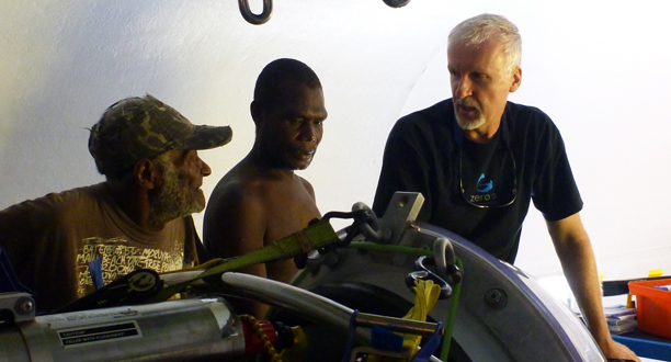 Photo: James Cameron and Papua New Guinean visitors view the sub